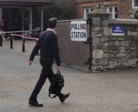 Going to vote - what does this man think he's doing?