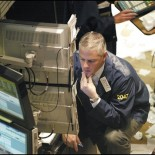 Floor trader at the New York Stock Exchange (picture Daamien at en.wikipedia)
