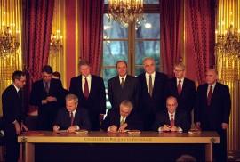 Serbian President Slobodan Milosevic, Bosnian President Alija Izetbegovic, and Croatia President Franjo Tudjman sign the Balkan Peace Agreement at the Quai d'Orsay (Foreign Ministry) in Paris, 14 December 1995: (Picture William J Clinton Presidential Library)